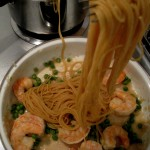 Mix pasta with shrimp and peas