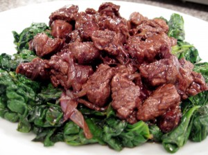 Balsamic Beef Bites with Caramelized Shallots and Sauteed Spinach