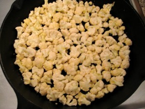 Chopped cauliflower in the skillet (kind of looks like popcorn, doesn't it?)