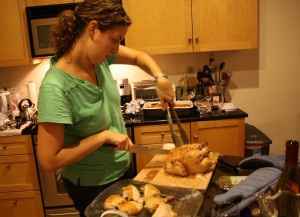 Rosh Hashana - Jackie carving the chicken
